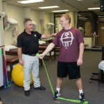 Physical Therapist with student
